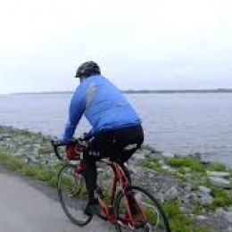 lone cyclist along lake Erie shoreline
